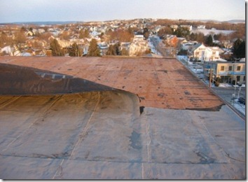 Roof Coatings - Mod-Bit Roof Peeled Back From High Winds